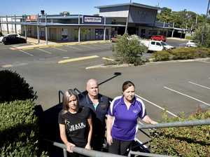 Retailers working in 'ghost complex' call out to residents