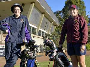 Family golfing duo on same course