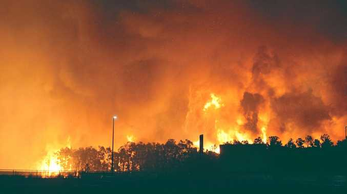 THE night sky burnt red when a fire threatened homes at Caloundra South in August last year, forcing evacuations from the Aura residential development.
