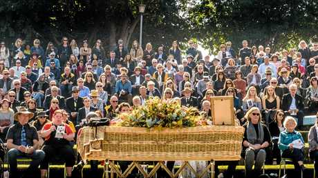 The casket in front of the large crowd at the farewell service of Andrew Tarrant at Memorial Park.