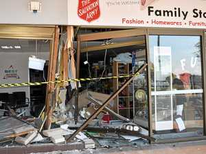 Car crashes through shop-front