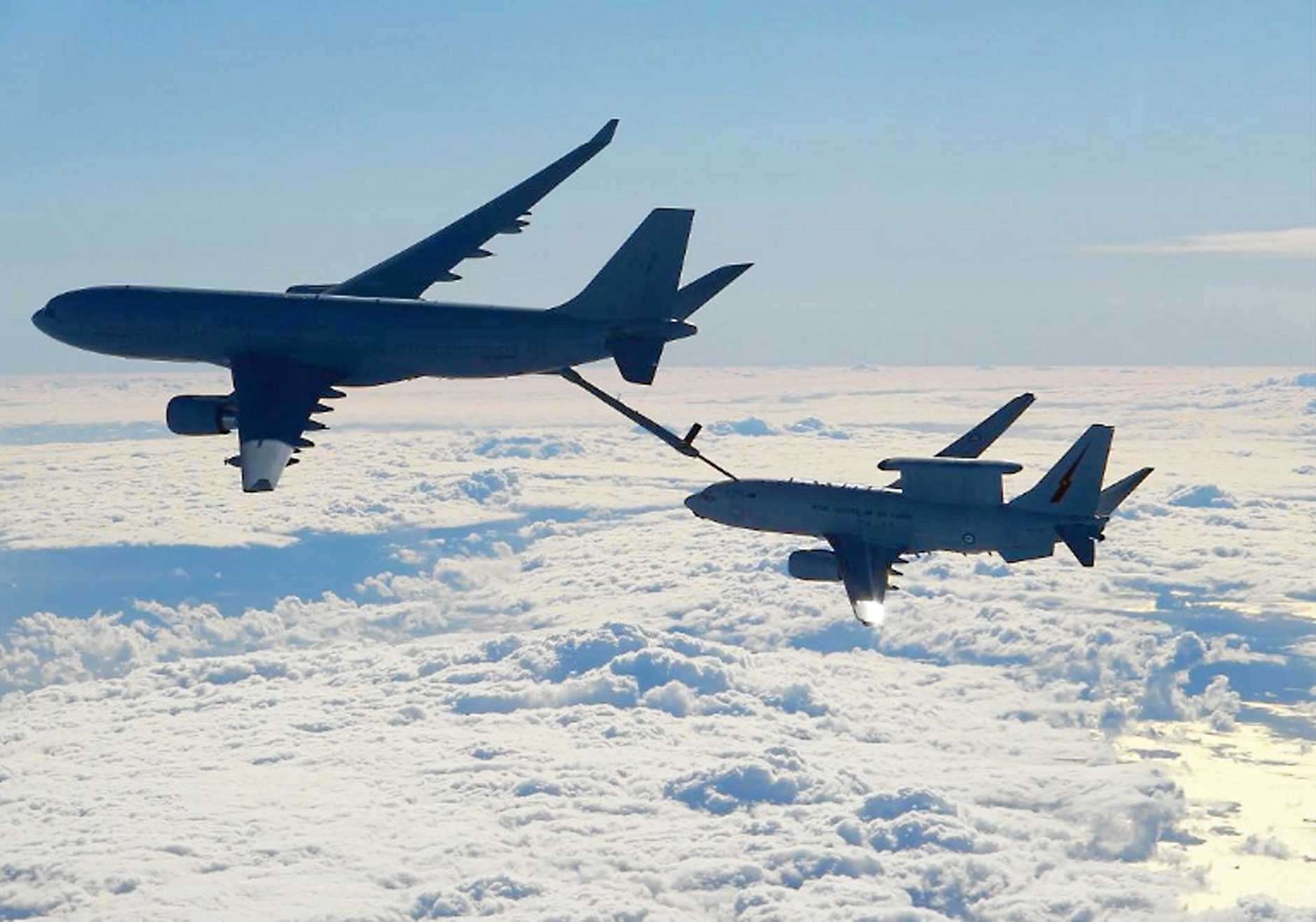 JOB DONE: A Royal Australian Air Force KC-30A Multi Role Tanker Transport aircraft refuels a coaltion plan during Operation Okra.