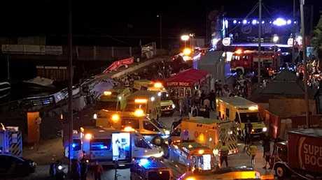 Ambulances at the scene of the collapse. EPA/Sxenick