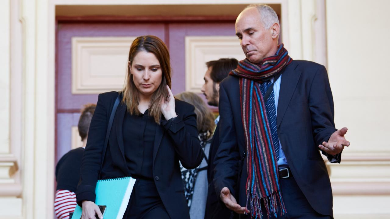 Lawyer for Hannah Quinn, Lauren MacDougall with the accused's father outside court on Tuesday. Picture: AAP