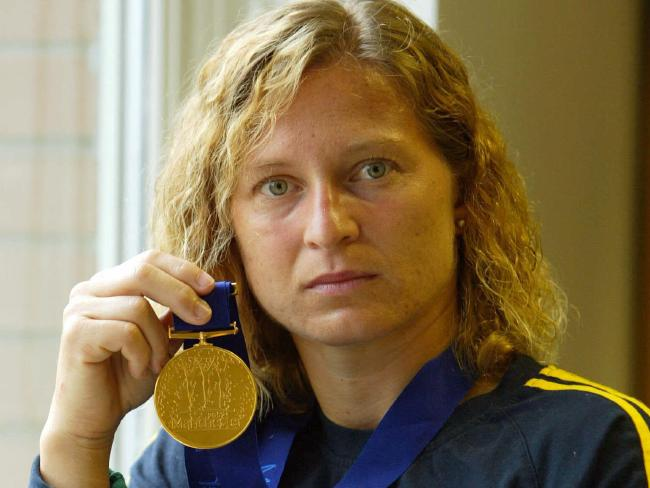 Pekli with her gold medal from the 2002 Commonwealth Games in Manchester .