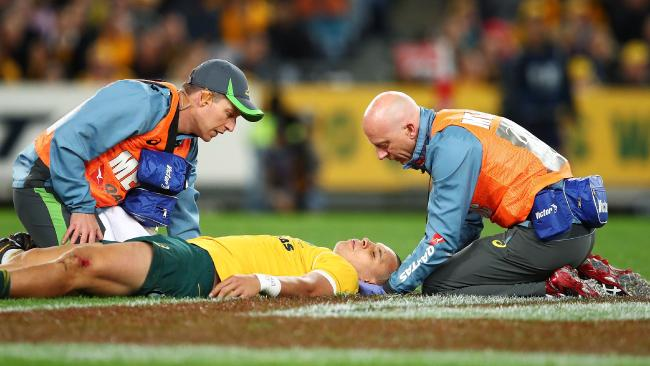 Matt Toomua receives attention after being concussed in 2016. Picture: Getty