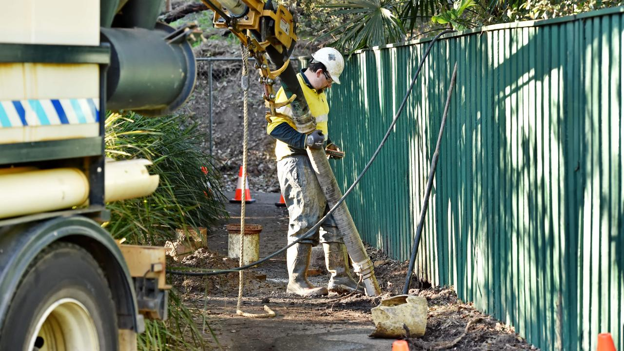 Sydney Water worker on scene of burst water main at the end of Brentford Road at Wahroonga on Monday. Picture: AAP