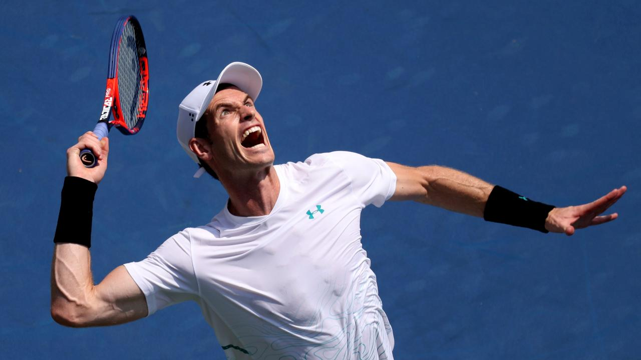 Andy Murray of Great Britain serves to Lucas Pouille.