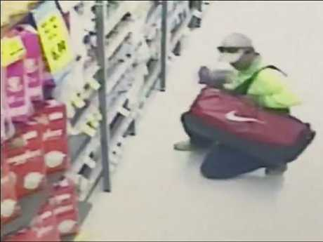 A man loads a bag with baby formula. Picture: Seven News