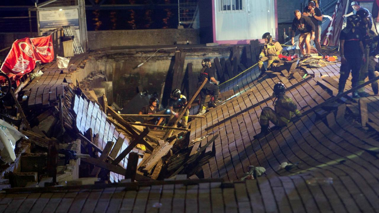 Firefighters search for victims after a wooden pier collapsed. Picture: EPA/Salvador Sas