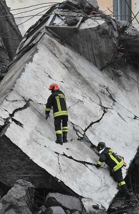 Rescuers work among the rubble of the collapsed Morandi highway bridge in Genoa, northern Italy.  Picture:  AP