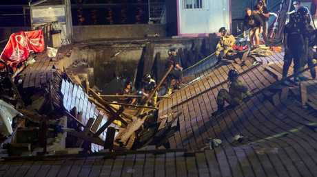 Several firefighters search for victims. Picture: EPA/Salvador Sas