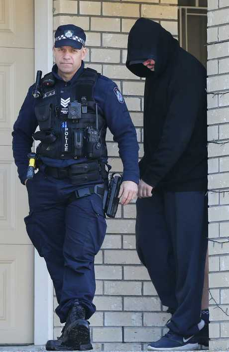 Police Raid a home at Fantail Court Gilston, confiscate items including computer equipment, and take a man into custody. Picture Glenn Hampson