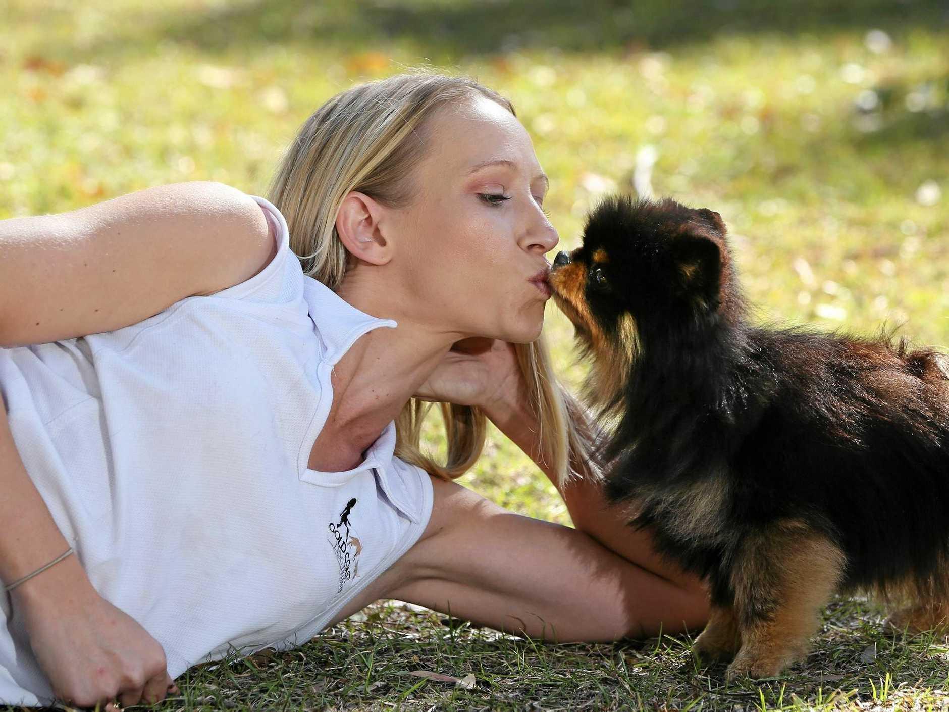 Bonnie the pomeranian and trainer Jasmine Delaney share a kiss.