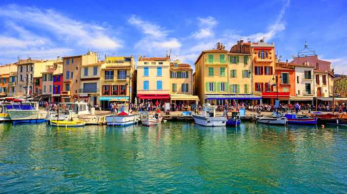 Colourful traditional houses on the promenade in the port of Cassis near Marseilles, France.