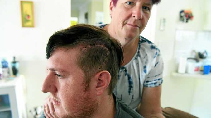 HEALTH BATTLE: Jenny Page and son Luke Johnson, who has lesions on his brain and recently had brain surgery to help him get a diagnosis to get a pension.