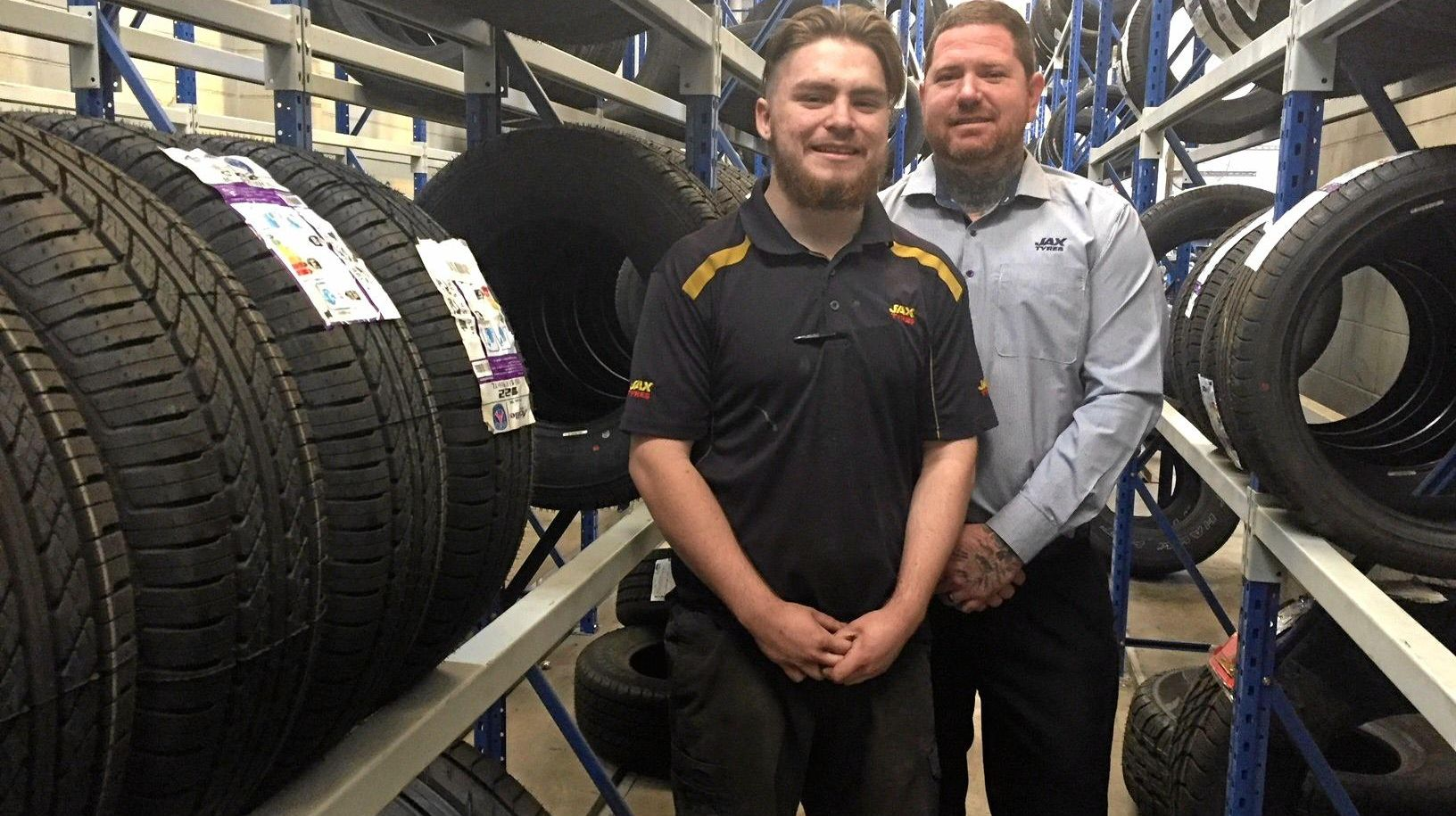 HARD AT IT: Wayne Kittle with his boss, Dale Spencer at Jax Tyres