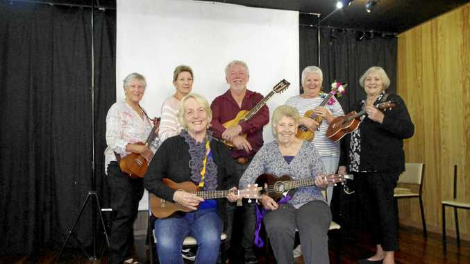 Gladstone Ukulele Club learning how to play along the way