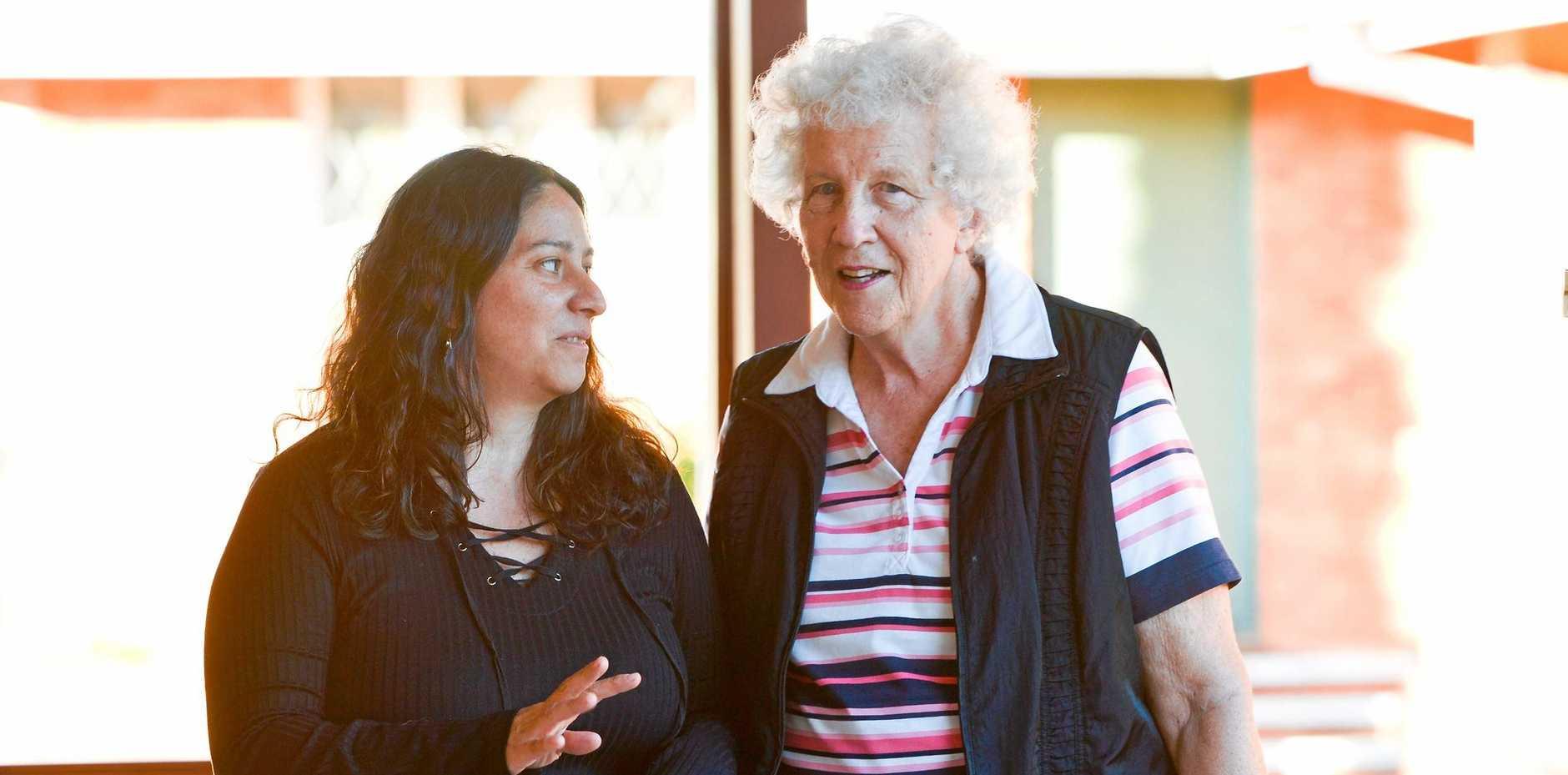 OPEN ARMS: Welcoming Intercultural Neighbours director Natalia Muszkat (left) with St Saviour's Anglican Church volunteer Carmelita Van Deventer.