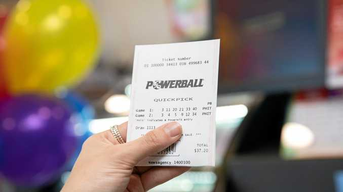 ARE YOU READY?: A massive $100 million Powerball jackpot has sent customers into a ticket- buying frenzy across the country.