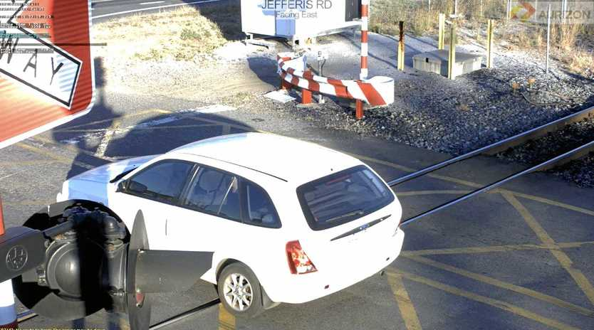 CLOSE CALL: A motorist narrowly avoided certain death after ignoring flashing lights at a level crossing on Jefferis Rd in Beecher last year.