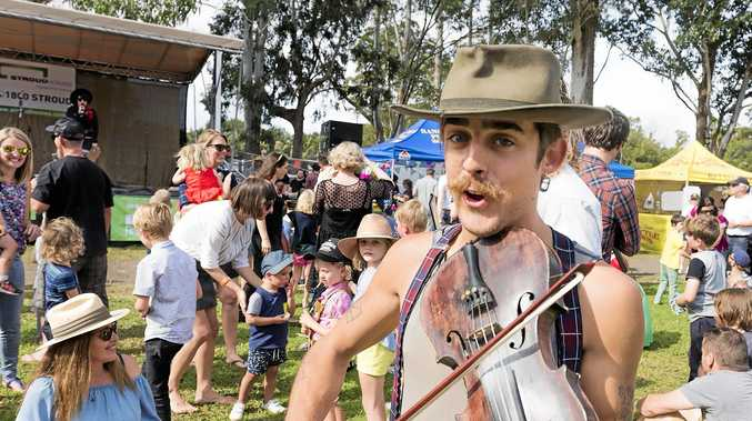 FUN: Brodie from the Button Collective was one of the many musicians who worked the crowd during the Bangalow BBQ & Bluegrass Festival 2017.