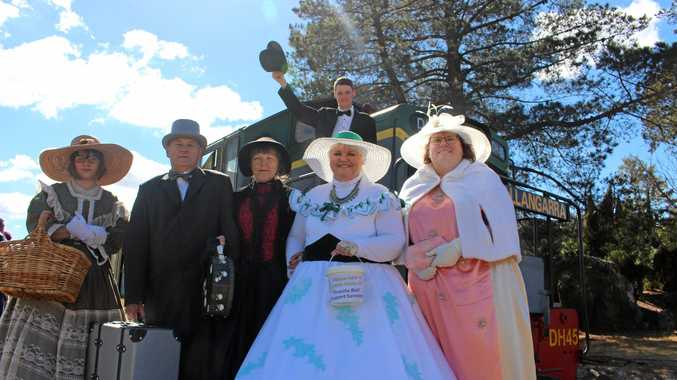 OLD-FASHIONED: (back) Liam Milliken (front) Sarah Browning, Michael and Jenny Cook, Karol Pasin and Melissa Bridge were all dressed up on Saturday to help raise funds for Granite Belt Support Services.