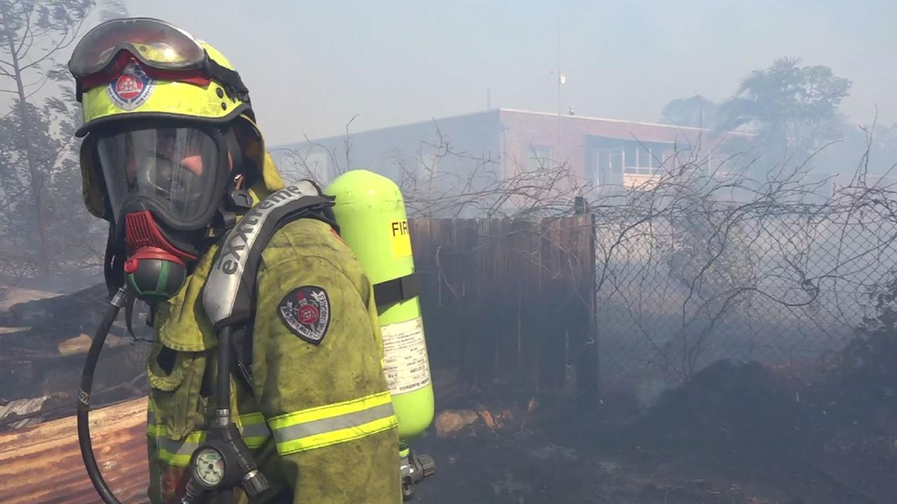 A firefighter prepares to fight the blaze at Bomaderry.