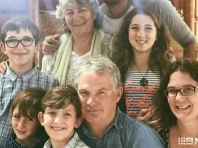 Peter Miles (centre), with his wife Cynda Miles (back), their daughter Katrina Miles (R) and her four children.
