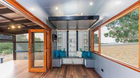 "Fernlea Tiny House by Tiny Footprint has a ""lift bed"" that descends at the touch of a button. Picture: The Melbourne Home Show"