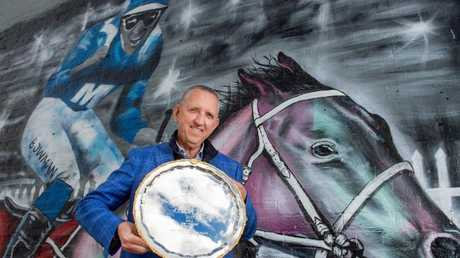 Winx owner Peter Tighe with one of the great mare's three Cox Plates. Picture: Jay Town