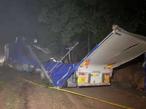 Truck rolls on highway