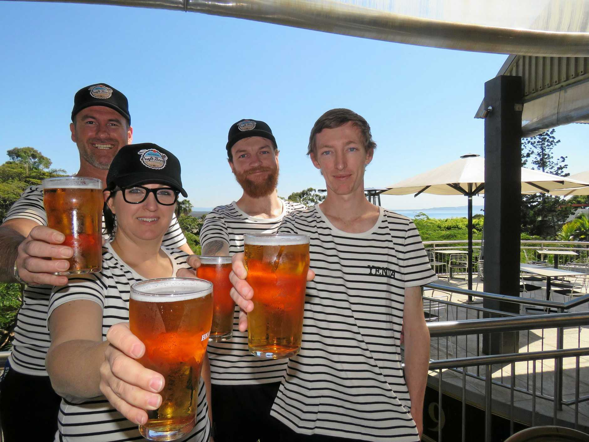 CHEERS: Noosa Reef Hotel staffers Allan, Stacey, Graham and Jake raise their glasses to the Noosa Craft Beer Fest.