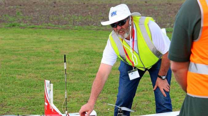 Jim Coyne checking one of the drones at last year's UAV Drone Challenge, which follows on from the Dalby Drone Forum.