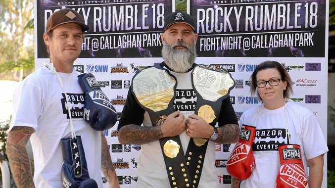 STAGE IS SET: Fighters Sean Watt and Bec Martin with Rocky Rumble 18 organiser Ruben Fraser-Parle (centre) with the title belts up for grabs at this weekend's fight night at Callaghan Park in Rockhampton.