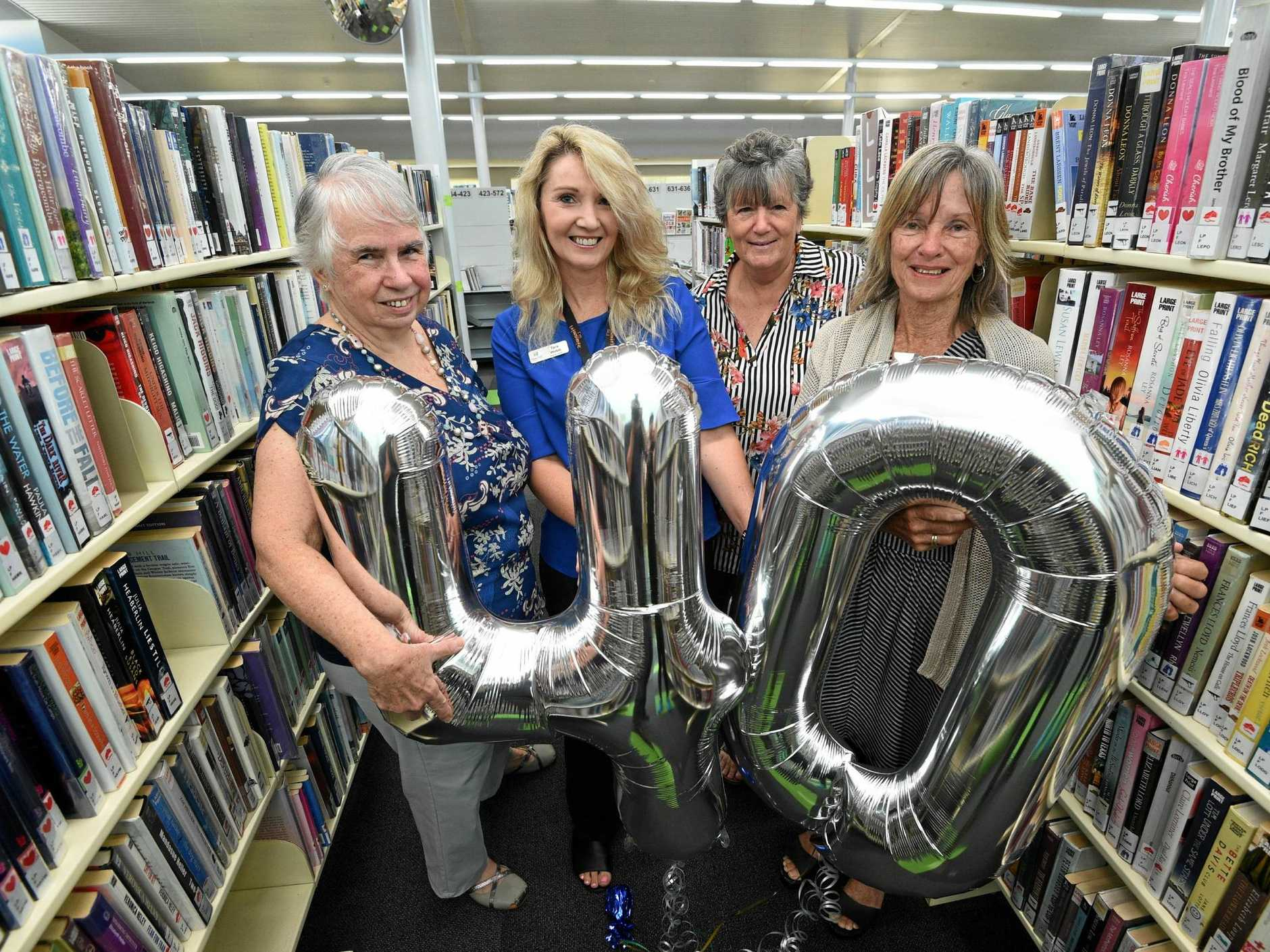 Celebrating the 40th anniversary of the Hervey Bay Library are (L) Sandra Maynes (first librarian), Tara Webb (current librarian) and former librarians Cathie McNamara and Linda Alexander.
