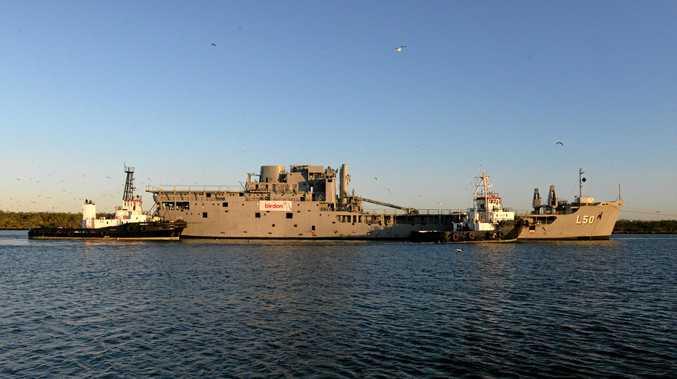 TOBRUK OUT: Ex-HMAS Tobruk leaves the Port of Bundaberg on its final voyage to its resting place 40km off the coast of Bundaberg.