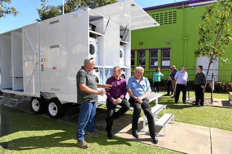 Phil Murphy who designed and built the trailer, Member for Bundaberg Dave Batt and David Trigg from the Hinkler Lions at the launch of the mobile washing and shower facility for the homeless and needy in the Bundaberg Community.
