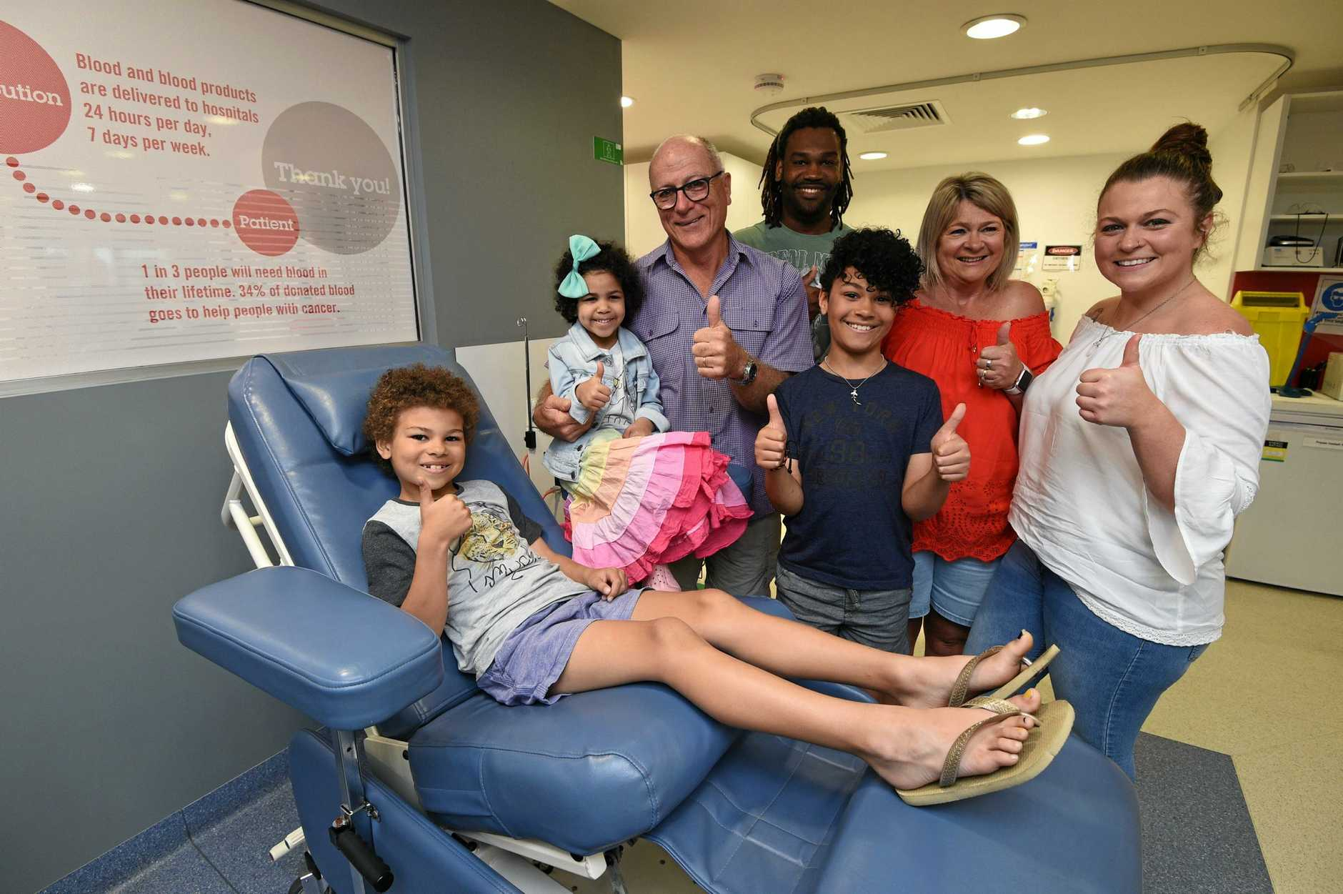 4 yr old Ivy Exantus with her grandfather Graeme Davies at the Hervey Bay Donor Centre - pictured with his wife Sharon and daughter Kimberley Exantus, her husband James and children Isaiah,10, and Jaye,7.