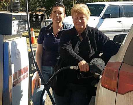Wowan Roadhouse owner Debbie Vale with Pat Briggs filling up her car.