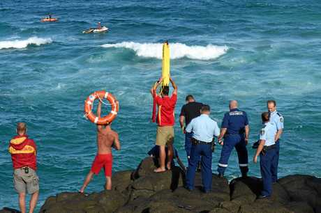 Police and Surf Life Savers search for a drowning victim from the rocks at the Fingal Head Lighthouse, Fingal Head in February 2018.