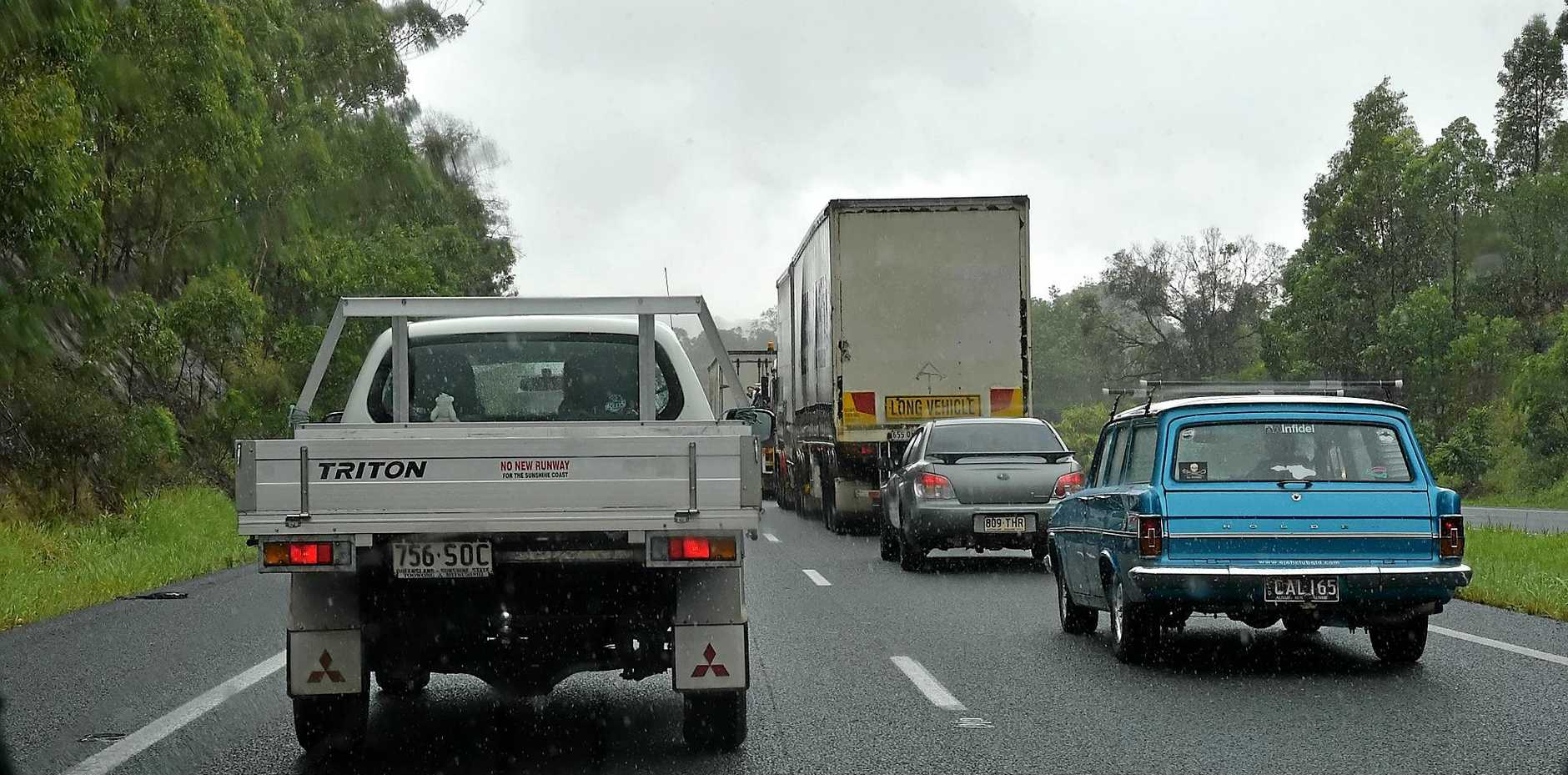 A TRUCK has rolled onto its side on the Bruce Highway at Beerwah causing major delays for motorists.