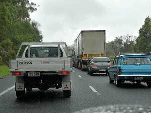 Truck rollover sees Bruce Hwy grind to halt