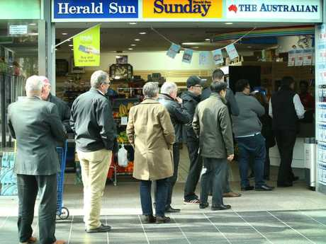 Dozens queue for a ticket to the $100 million Powerball at Southgate. Picture: David Caird