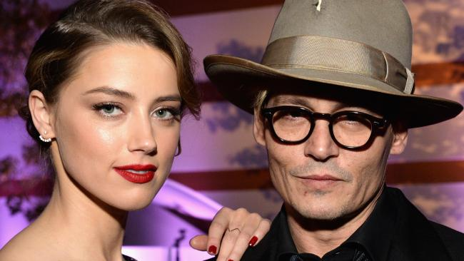 The marriage between Amber Heard and Johnny Depp imploded after a violent argument about poo, a friend claims. Picture: Michael Kovac/Getty Images for Art of Elysium
