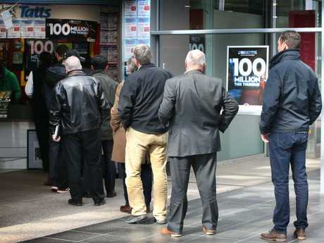 Queues build for tickets to the $100 million jackpot. Picture: David Caird