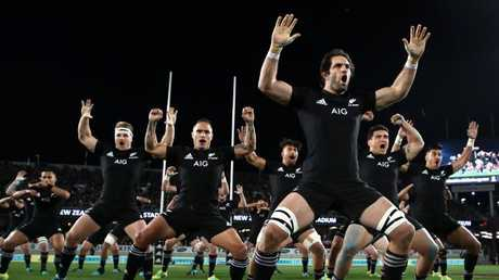 Sam Whitelock of the All Blacks performs the haka at Eden Park.