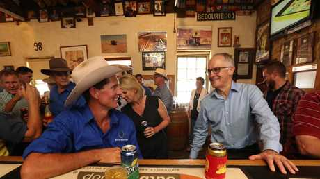 Prime Minister Malcolm Turnbull at Birdsville Hotel with local Kerry Morton. Picture: Peter Wallis
