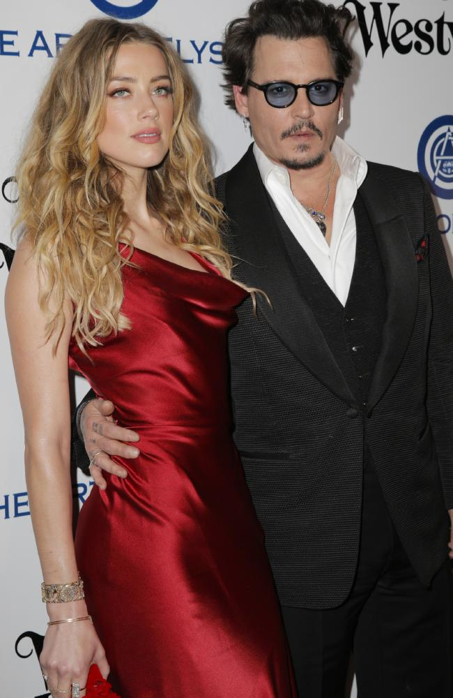Amber Heard and Johnny Depp pictured in 2016 just weeks before the poo incident. Picture: Alison Buck/Getty Images