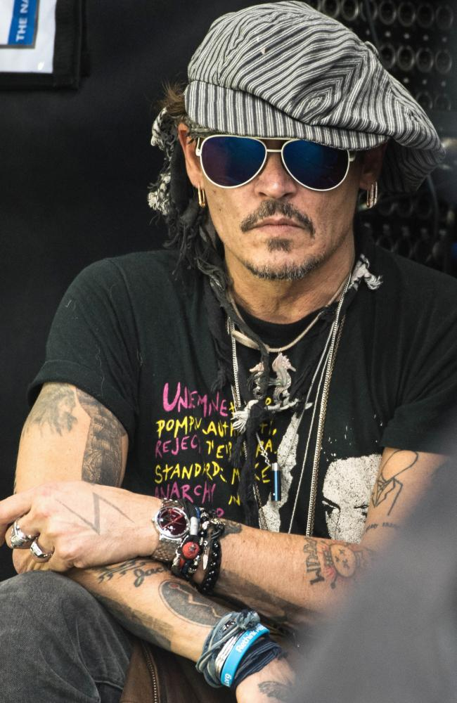 Johnny Depp claims the poo incident was the catalyst for the violent argument that led to the breakdown of their marriage. Picture: Ian Gavan/Getty Images